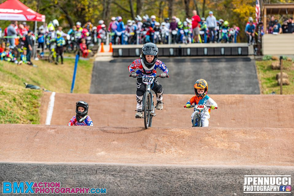 3 riders competing in a BMX race