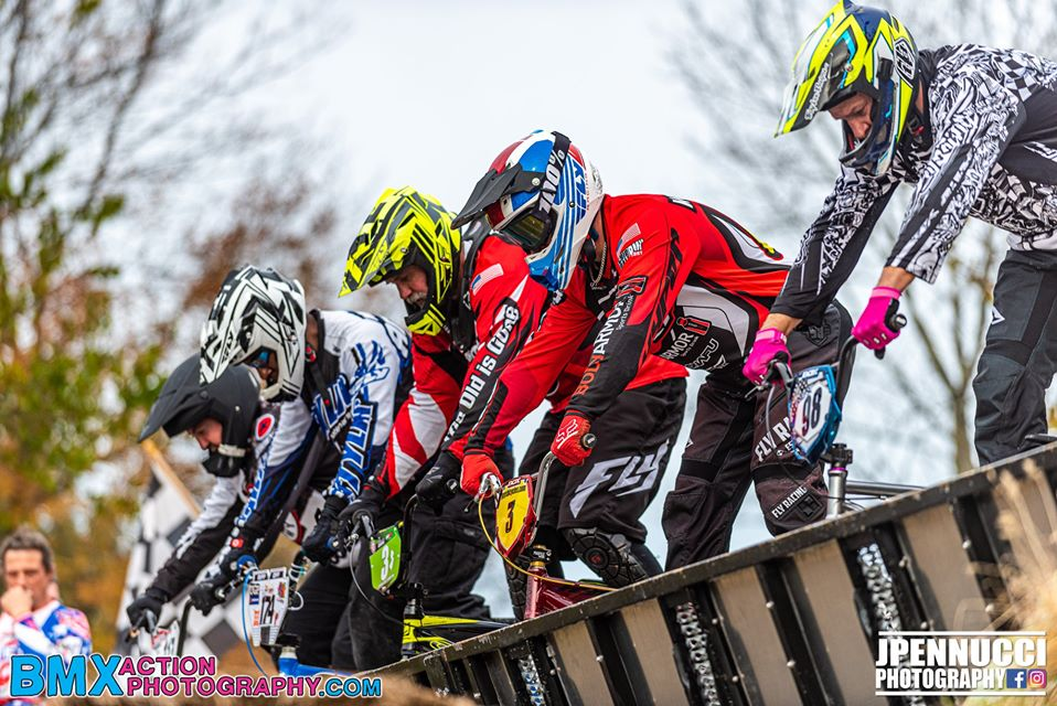 Adult riders competing in a BMX race