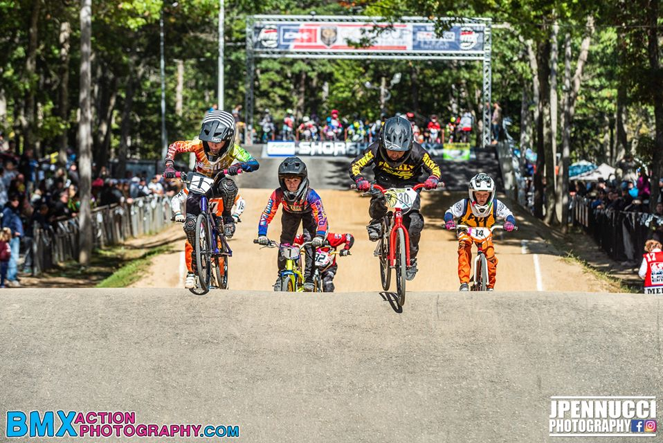 Riders compete in a BMX race