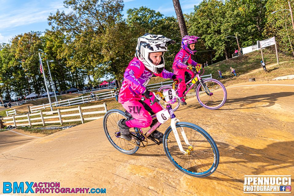 Girl riders competing in a BMX race